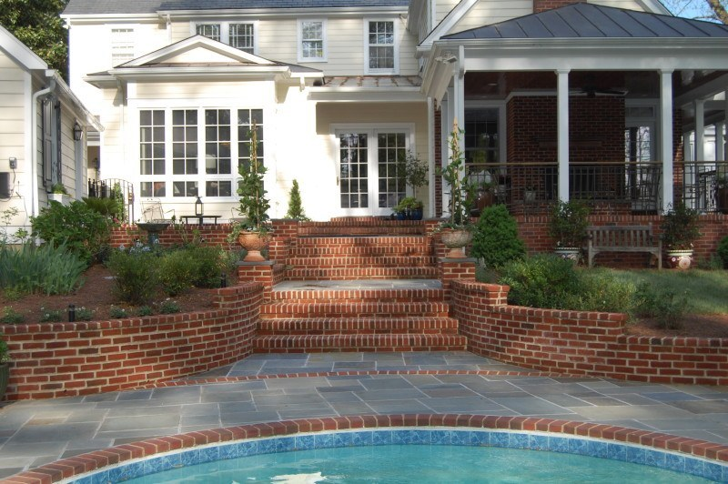 The pool used to be separated from the house by a fence.  Susan and Walter reconfigured the space, moving the fence to the perimeter and adding broad steps leading directly to the pool.
